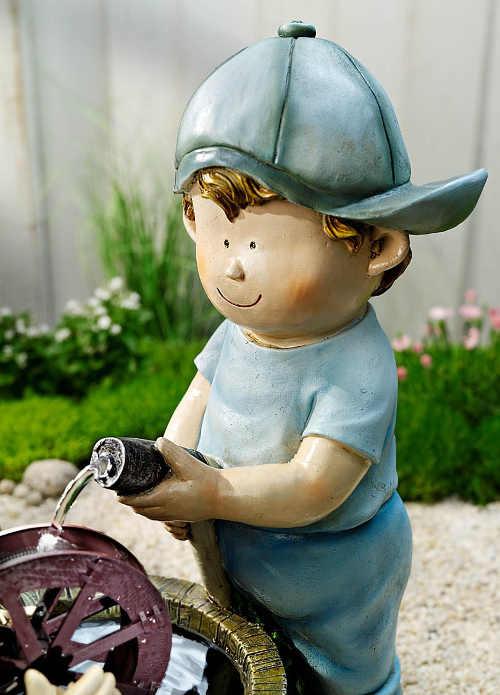 Stříkající postavička na zahradu